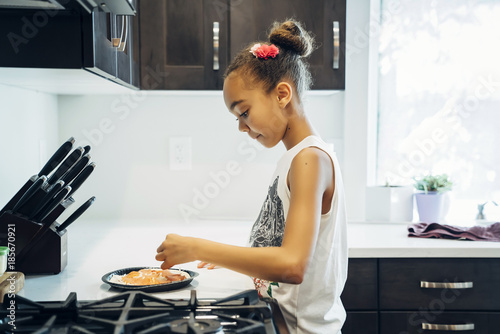 Girl making pizza in home kitchen