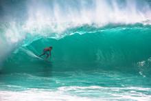 Surfer Riding Big Wave At Pada...