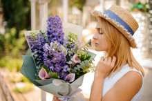 Woman Holds A Bouquet Of Calla...