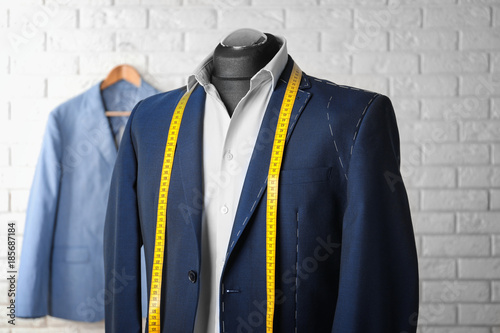 Fototapeta Semi-ready suit on mannequin in atelier obraz