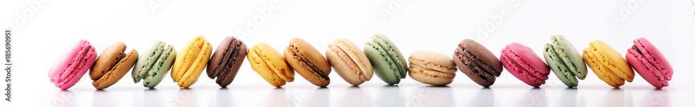 Fototapeta Sweet and colourful french macaroons or macaron on white background, Dessert