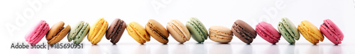 Photo Stands Dessert Sweet and colourful french macaroons or macaron on white background, Dessert