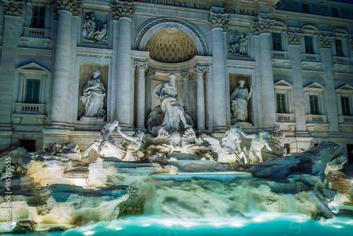 Illuminated Trevi fountain in Rome Wallpaper Mural