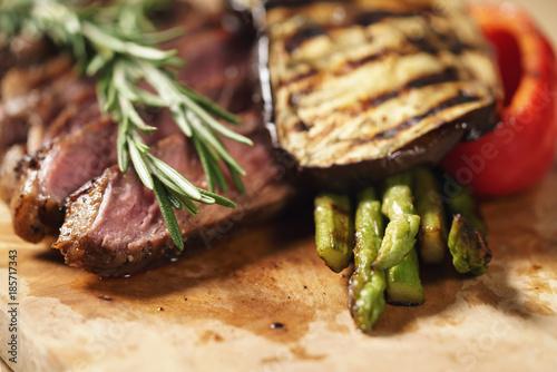 Wall Murals Ready meals sliced rib eye steak on wood board