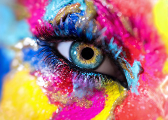 Woman eye with colorful makeup closeup