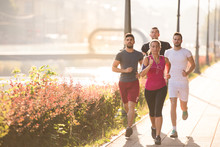 Group Of Young People Jogging ...
