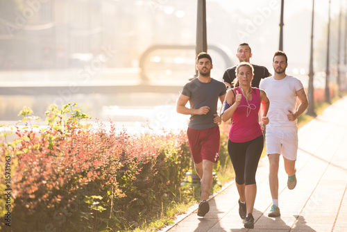 Valokuva group of young people jogging in the city