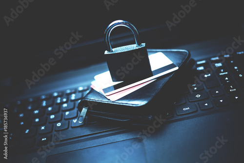 Lock with credit cards and wallet on a laptop. Fotobehang