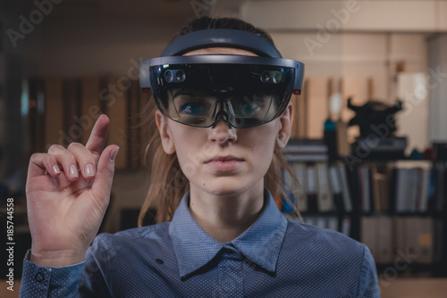 Portrait of young Caucasian female using augmented reality holographic hololens Canvas Print