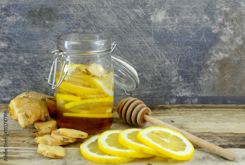 Closeup image of ingredients for natural cold or flu remedy includes ginger, hon Poster