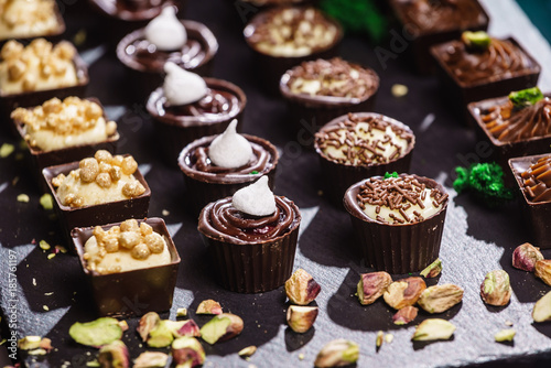 Canvas Prints Candy chocolate sweets on black background