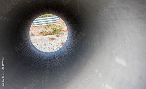 Through a barrel concrete pipe - Buy this stock photo and