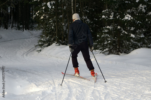 Fotobehang Wintersporten A young man rides cross-country skiing. Active winter. Active guests. Amateur sports.