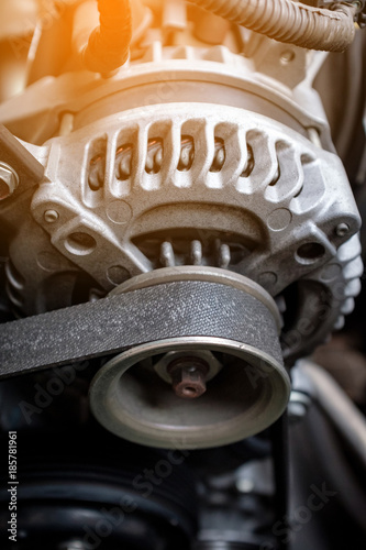 Photo details of car engine, alternator or electrical generator with sunlight effect