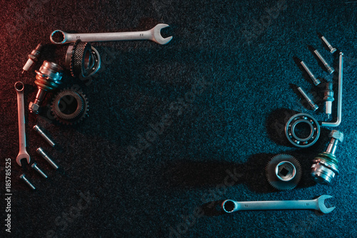 Photo Frame of bearings, spanners, bolts on a dark background