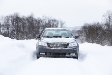 The Car Stands On A Snow-cover...