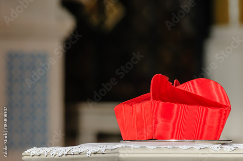 Photo A cardinal's Beretta hat sits on a table during a requiem mass