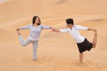 Indonesian Girl And Filipino Boy Doing Yoga On Dune 7, Walvis Ba