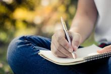 Close Up Young Women Writing O...