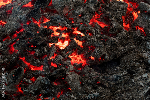 Fotografiet Lava flame on black ash background
