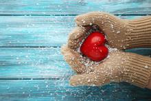 Hands In Beige Gloves Holding ...