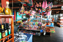 Beautiful And Colourful Silk And Cotton Indian Scarfs, Bags And Bottles Sold In Souvenir Shop Market Stall