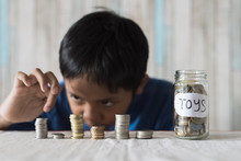 Young Boy Counting His Coins/s...