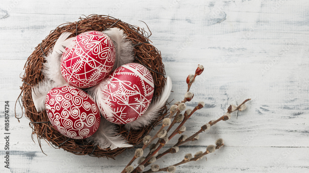 Fototapety, obrazy: Pysanky, decorated Easter eggs in the nest