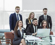 concept of teamwork - a successful business team in the workplace in the office