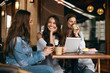 canvas print picture - Friends In Cafe. Beautiful Smiling Girls Using Tablet.