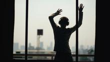 Silhouette Of Young Man Dancin...