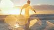 Beatiful muscular man silhouette against sunset walking away