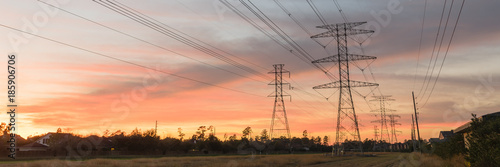 Industrial background group silhouette of transmission tower (or power tower, electricity pylon, steel lattice tower) at bloody red sunset Wallpaper Mural