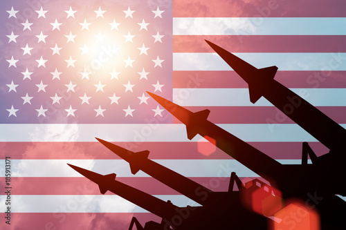 Antiaircraft rockets silhouettes on background of United States of America flag Canvas Print