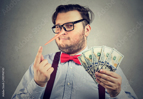Man having illegally earned money Fototapeta