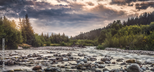 Poster Riviere Bela River with Water Flowing over the Rocks at Sunset in Slovakia