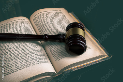 Photo law theme, mallet of the judge, justice scale, old books