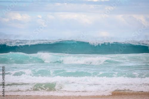 Scenic view of ocean waves splashing on the beach