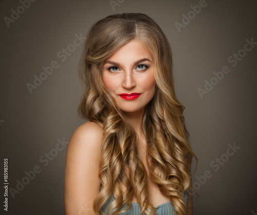 Healthy Woman Model with Blonde Curly Hairstyle and Makeup. Perfect Girl on Dark Background