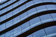 Corporate concept - detail of modern glass building in Milan