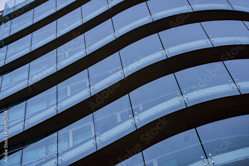 Corporate concept - detail of modern glass building in Milan Fototapet