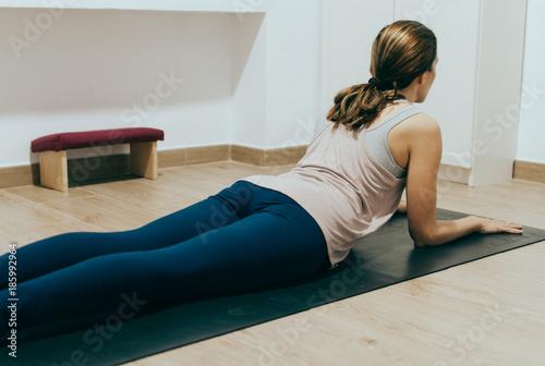 Woman doing yoga at home Fotobehang