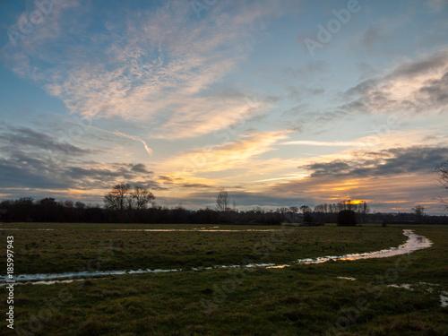 Poster Donkergrijs empty wet grass field low light sunset landscape dedham plain empty no people dramatic sky