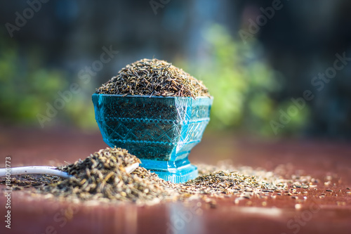 Close up of Shahjerra,Carum carvi,Caraway seeds in a bowl on wooden surface Wallpaper Mural