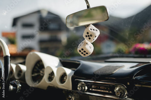 Photo  fuzzy dice in the car