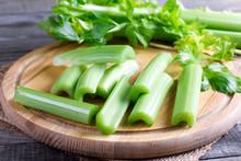 Fresh Celery Stems On Wooden C...