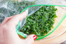 Frozen Greens In A Bag On A Cu...