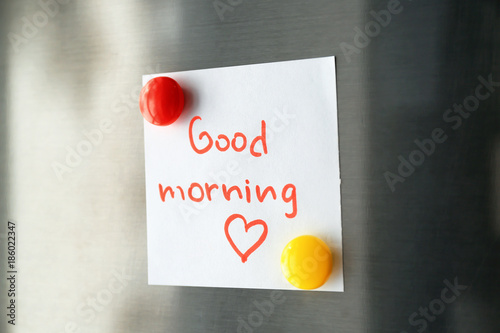 "Note with words ""Good morning"" on refrigerator door"