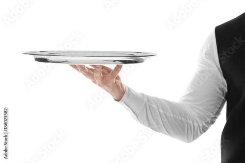 Fototapeta Waiter with empty tray on white background obraz
