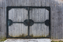 Large Wooden Gate In An Iron F...